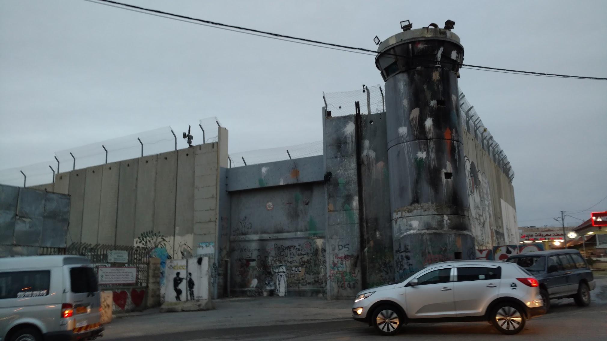 Figure 2  The wall outside Bethlehem  - with Banksy artwork